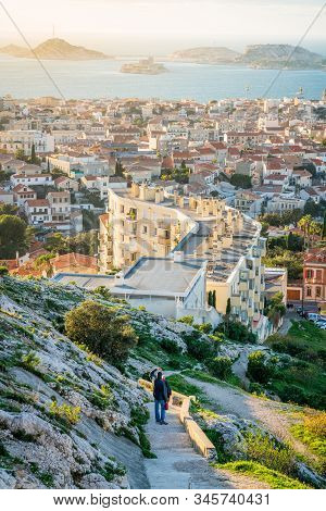 Marseille Vertical Cityscape With People Looking At Sunset On Frioul Islands In Marseille France