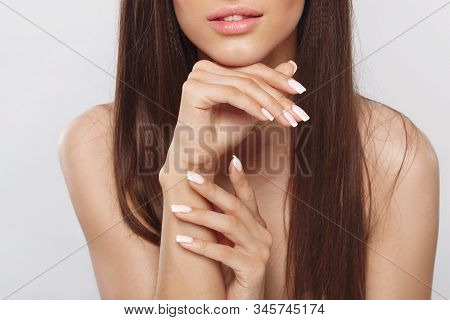 Beautiful Woman With A French Manicure Nail , Skin Care Concept, Beautiful Skin. Portrait Of Female