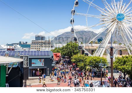 Cape Town, South Africa - January 01 2020: Giant Ferris Wheel  In Front Of Table Mountain At The V &