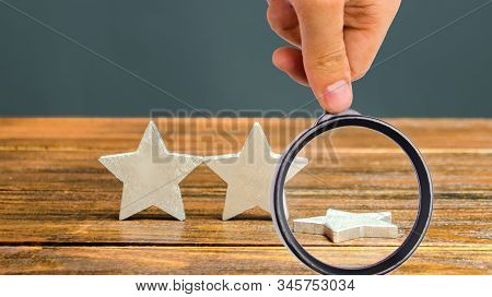 The Fall Of The Third Star. The Concept Of Falling Rating Hotel Or Restaurant. Deterioration In Serv