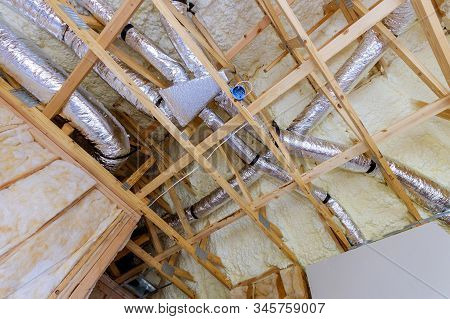 Installation Of Hvac Tubing Vents Heating System On The Roof, Installing Attic Insulation Material I