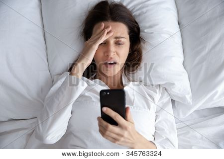 Top View Unhappy Woman Using Phone, Bad News, Oversleep