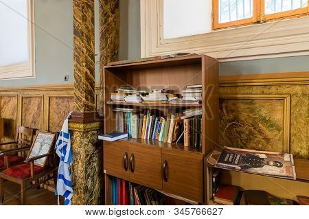 Kutaisi, Georgia, October 13, 2019 : A Bookcase Stands By The Wall In The Hall Of The Old Synagogue