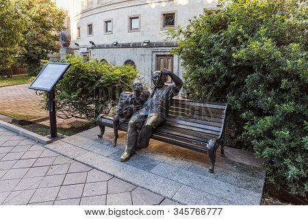 Kutaisi, Georgia, October 13, 2019 : Bronze Sculpture Of Two People Sitting On A Bench And Watching