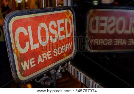 Sign On Closed Shop With The Words Sorry We're Closed Word