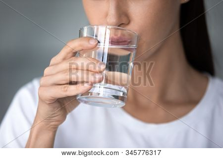Close Up Woman Drinking Pure Water, Holding Glass In Hand
