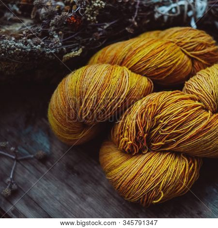 Bright Yellow Wool Yarn Skeins In Rustic Background. Hobby And Craftsmanship Concept.