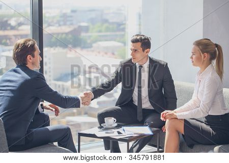 Interviewer Shaking Hand Of An Interviewee During A Job Interview In Office