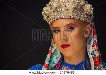folk clothes and pearl crown on an european woman