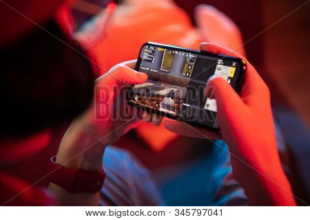 Moscow, Russia - December 2019: Kid Play Pubg: Mobile On Iphone 11 Pro Smartphone Close-up