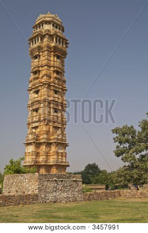 Ornate carved stone tower built to celebrate an ancient victory. Chittaugarh Rajasthan India. poster