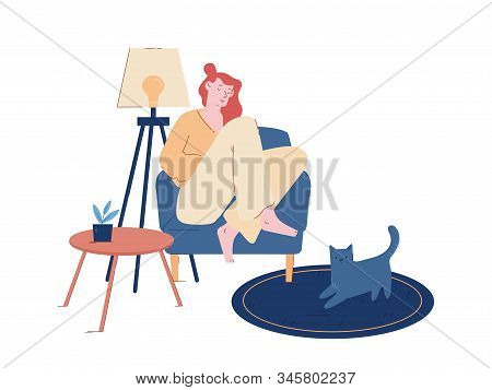 Young Woman Sitting On Cozy Armchair At Home Sleeping Or Read Interesting Book With Cat Sitting On F