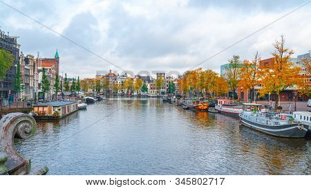 Amsterdam, Netherlands 15 October 2019 - Amsterdam Canals With Boats And Houses.