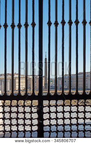 Iron Gate And Arch At Entrance Of Saint Peters Basilica At St. Peters Square In Vatican City