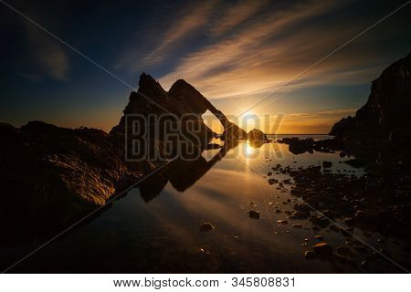 Bow Fiddle Rock Reflection In Sunrise Light, Portknockie, Scotland