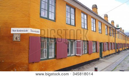 Copenhagen, Denmark - Jul 06th, 2015: Nyboders Mindestuer Museum - Yellow Historical Buldings In Old