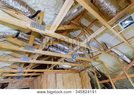 Installing Attic Insulation Material Is Sprayed With Liquid Foam Of Heating System Air Condition Sys