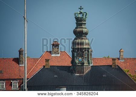 The Roof With An Ornate Clocktower Of The Seventeenth-century Building, Naval Brig, Copenhagen