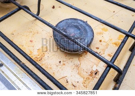 Dirty Unhygienic Surface Of Kitchen Gas Stove With Grease And Soot Stains, Close Up