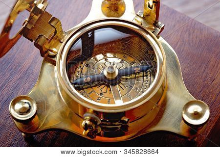 Crop Image With Details Of An Antique Nautical Compass And Sundial