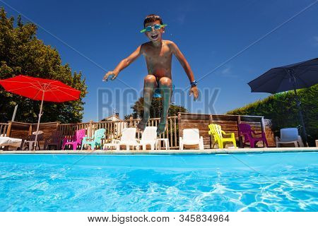 Little Happy Screaming Boy Child Jump In The Swimming Pool Mid Air Portrait