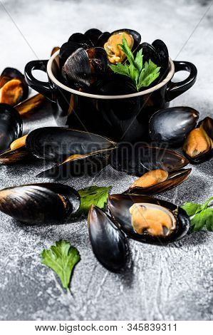 Raw Fresh Mussels In Shells. The Concept Of Cooking Seafood. Gray Background. Top View