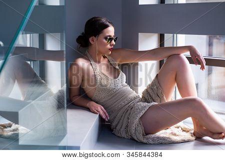 Portrait Of A Beautiful Woman In A Dress. Elegant Chic Female Model In Fashion Sunglasses. Beautiful