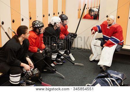 Portrait Of Female Hockey Team Captain Giving Motivational Pep Talk In Locker Room Before Match, Cop