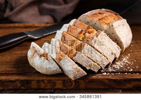 Sourdough White Bread Sliced On Wooden Cutting Board, Closeup View. Wheat Bread