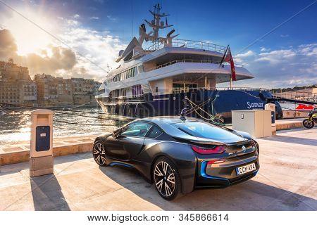 Birgu, Malta - January 10, 2019: Sport electric car BMW I8 parked at the marina in Birgu, Malta. The BMW i8 is a plug-in hybrid sports car developed by BMW.