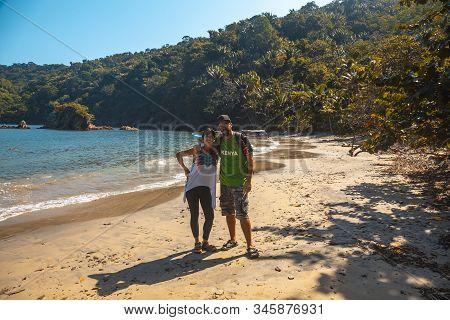 A Couple Of Tourists On The Beach Of Puerto Caribe In Punta De Sal In The Caribbean Sea, Tela. Hondu