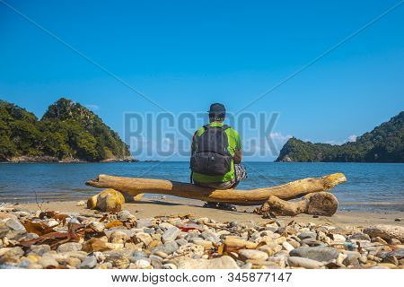 Tela, Honduras »; January 2020: A Young Man On The Beach Of Puerto Caribe Sitting In Punta De Sal In
