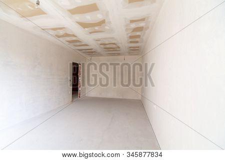 New Empty Room Under Construction. Plaster Walls. New Home. Concrete Walls. Interior Renovation.