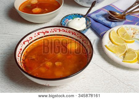 Rustic Bowl With Hodgepodge Meat Soup Made Of Various Kind Of Meat, Sausages And Vegetables