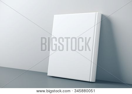 Empty Closed White Hardcover Book Leaning On Concrete Wall. Education Concept. Mock Up, 3d Rendering