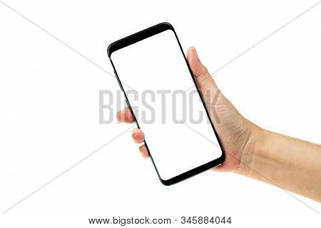 Woman Hand Holding Black Mobile Phone With White Screen At The Background, Smartphone Blank Screen