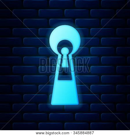 Glowing Neon Keyhole Icon Isolated On Brick Wall Background. Key Of Success Solution, Business Conce