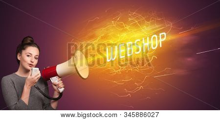 Young girld shouting in megaphone with WEBSHOP inscription, online shopping concept