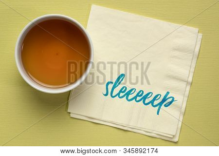 sleeeep - take a good sleep or nap, handwriting on a napkin with a cup of herb tea, healthy lifestyle and rest concept