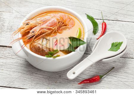 Tom Yum traditional Thai soup with seafood, mushrooms, coconut milk and hot spices