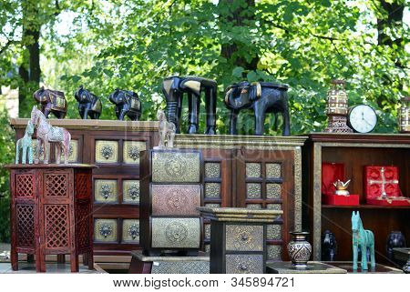 Indian Antique Furniture With Traditional Interior Statuettes Of Elefants, Horses At The Bazaar Outd