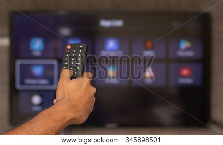 Maski, India 18, January 2020 - Hands Holding Remote Control With Different Online Subscription Apps