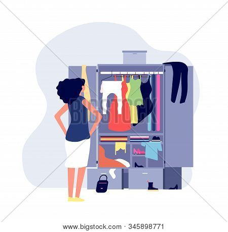 Opened Wardrobe. Girl Stand Front Closet. Stack Clothes On Floor, Fashion Problems And Chaos. Organi