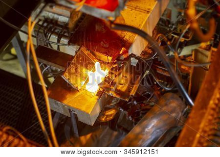 Glassworks. Glass Industry. Burning Blanks Of Glass Bottles In An Industrial Stove
