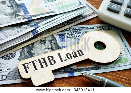 First-time Homebuyer Fthb Loan Printed On The Wooden Key.