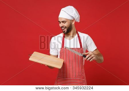 Handsome Young Bearded Male Chef Cook Or Baker Man In Striped Apron White T-shirt Toque Chefs Hat Po