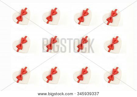 Gift Box In The Form Of A Heart With A Red Bow On A White Background.  Gift Box Patern