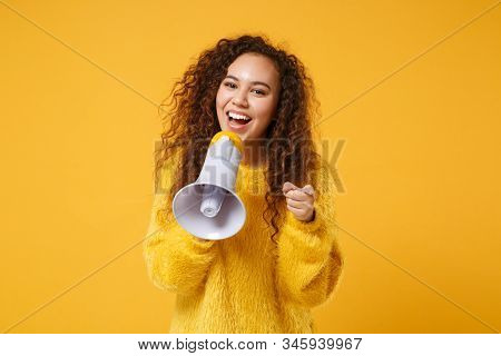 Funny Young African American Girl In Fur Sweater Posing Isolated On Yellow Orange Wall Background. P