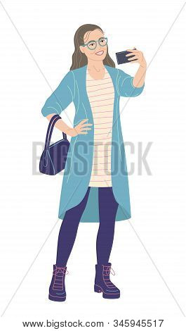 Young Woman With Glasses Taking Selfie Photo On Smartphone. Bespectacled Girl In Cardigan And Boots