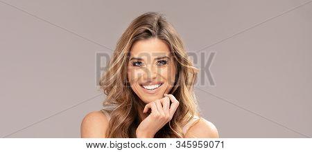 Portrait Of Beautiful Smiling Happy Woman.